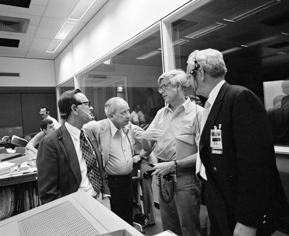 "Jack Kinzler, second from right, seen in June 1973 with other NASA officials in Houston, was known as ""Mr. Fix-it"" in the agency for his ability to find solutions to unexpected problems. He died March 4 at 94."