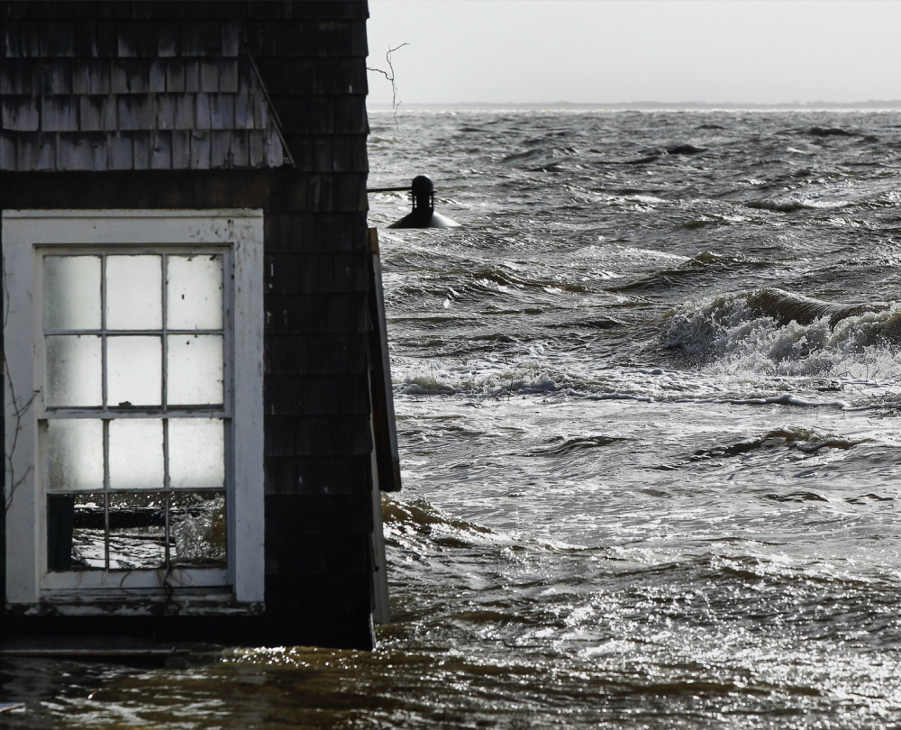Homes like this one in Bellport, N.Y., caught in flooding from Hurriane Sandy in 2012, may now be sold without new owners facing sharply higher flood insurance premiums.