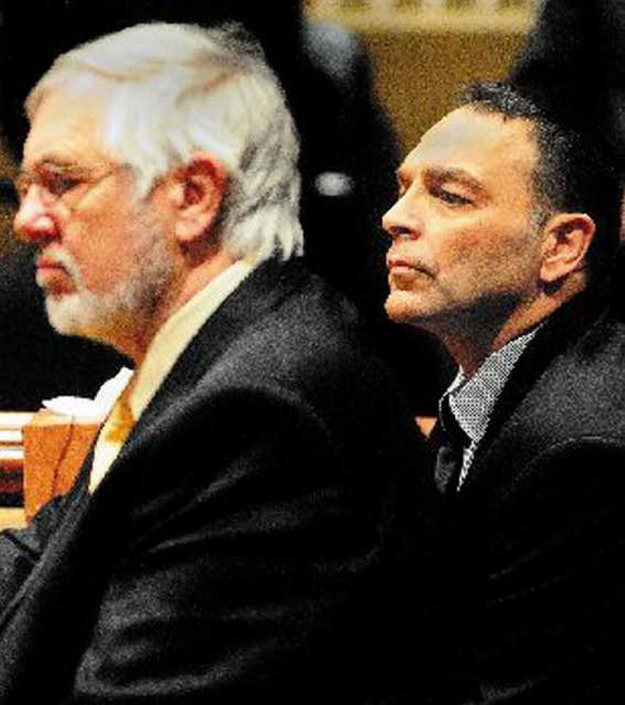 Andrews Campbell, left, the defense attorney for Raymond Bellavance Jr., listens to the verdict as a jury in 2011 finds Bellavance guilty of arson related to a 2009 fire that destroyed the Grand View Topless Coffee Shop in Vassalboro.