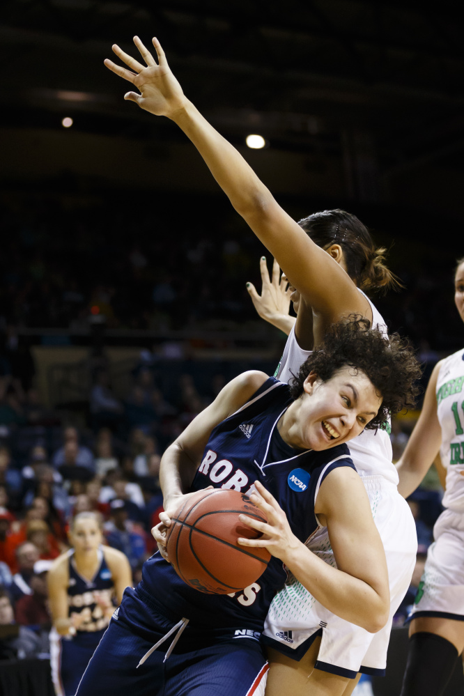 Robert Morris forward Artemis Spanou, left, dribbles around Notre Dame forward Taya Reimer during the second half in a first-round game in the NCAA women's college basketball tournament, Saturday, in Toledo, Ohio.
