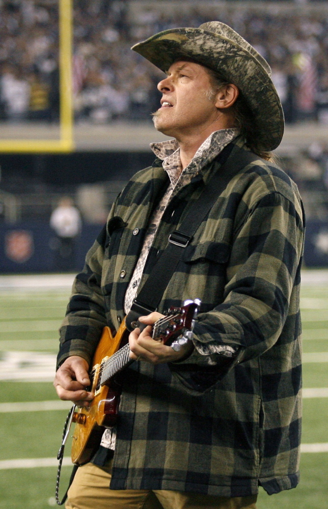 Ted Nugent plays at a game between the Dallas Cowboys and Philadelphia Eagles in January 2010.
