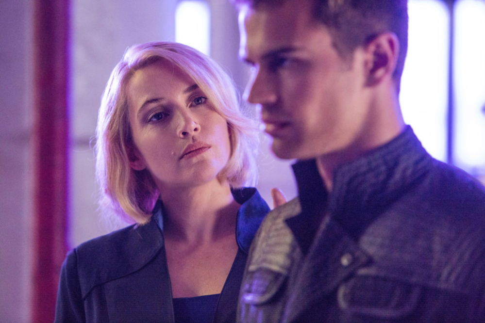 "Theo James with Kate Winslet, who plays the leader of the ""Erudite"" faction, which prizes knowledge, in ""Divergent,"" set in a futuristic Chicago."
