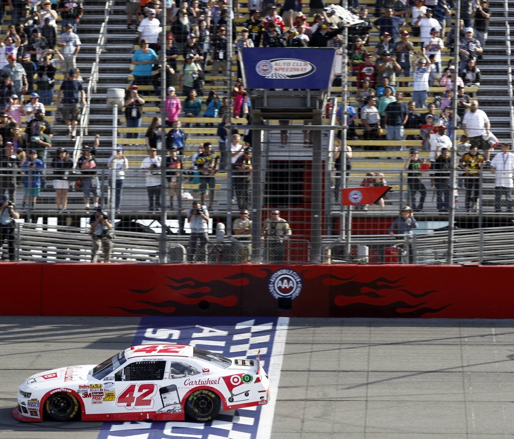 Kyle Larson crosses the finish line to win his first NASCAR Nationwide Series auto race, as he held off Kevin Harvick and Kyle Busch at Fontana, Calif., on Saturday. Larson, 21, is regarded as one of NASCAR's promising young drivers.