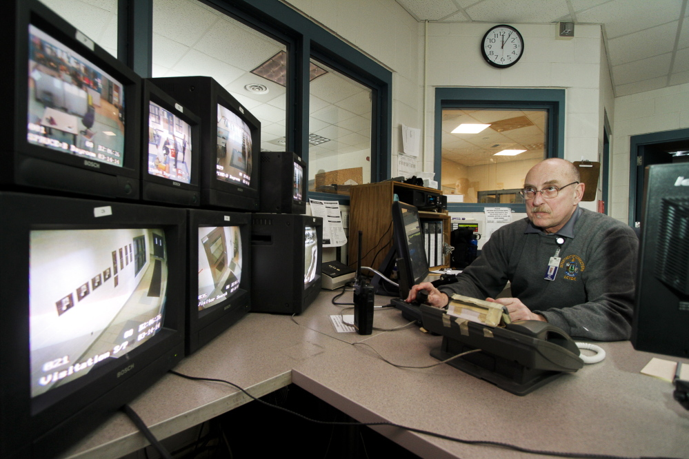 Juvenile Program Worker David Bailey monitors security cameras in the Central Control office at Long Creek Youth Development Center on March 14.
