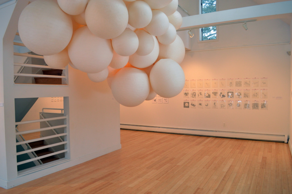 """Orbs"" is Sarah Bouchard's grouping of handmade paper spheres up to 4 feet in diameter."