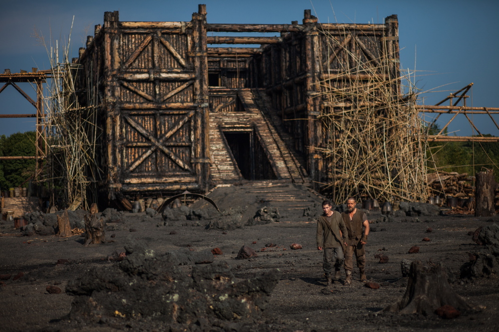 "Logan Lerman, left, and Russell Crowe in a scene from ""Noah."" The movie has sparked controversy among some conservative Christians in the U.S., who object to its interpretation of the Bible story, and among some Muslims who say it contradicts a generally agreed upon taboo in Islam by depicting a prophet."