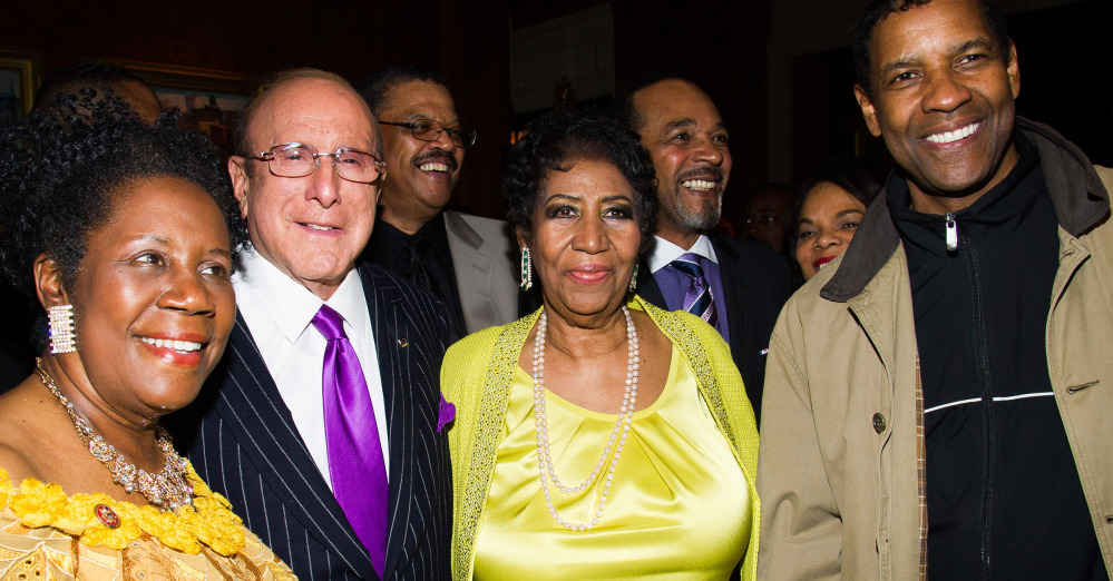 Helping Aretha Franklin, center, celebrate her 72nd birthday in New York on the weekend were, from left, Rep. Sheila Jackson Lee, Clive Davis and Denzel Washington.