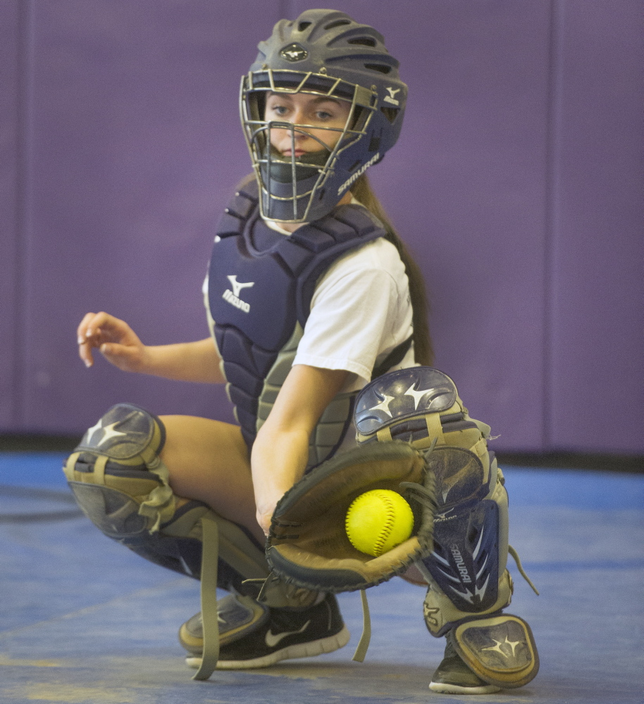 Cheverus junior Margaret Rigney gloves a pitch during the softball team's first day of preseason practice on Monday. Rigney is expected to be the team's regular catcher this season.