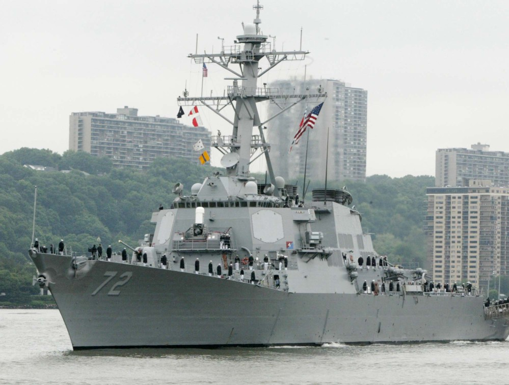 The USS Mahan, a guided-missile destroyer, moves up the Hudson River in New York. A sailor was fatally shot aboard the USS Mahan at Naval Station Norfolk late Monday.