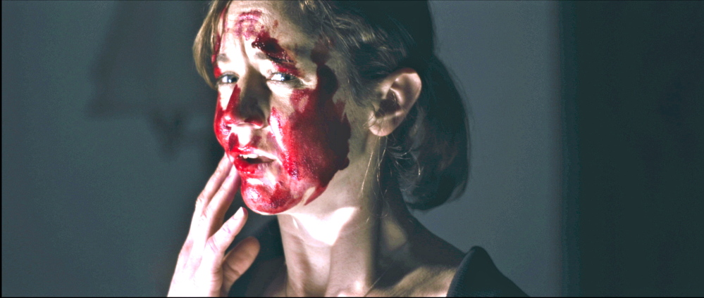 "Casey Turner is bloodied in a scene from ""The Hanover House."""
