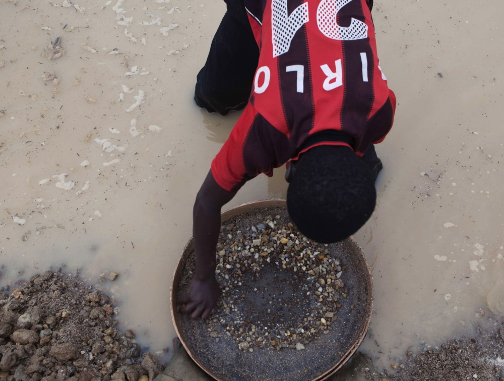 A miner pans for diamonds in Koidu, Sierra Leone.