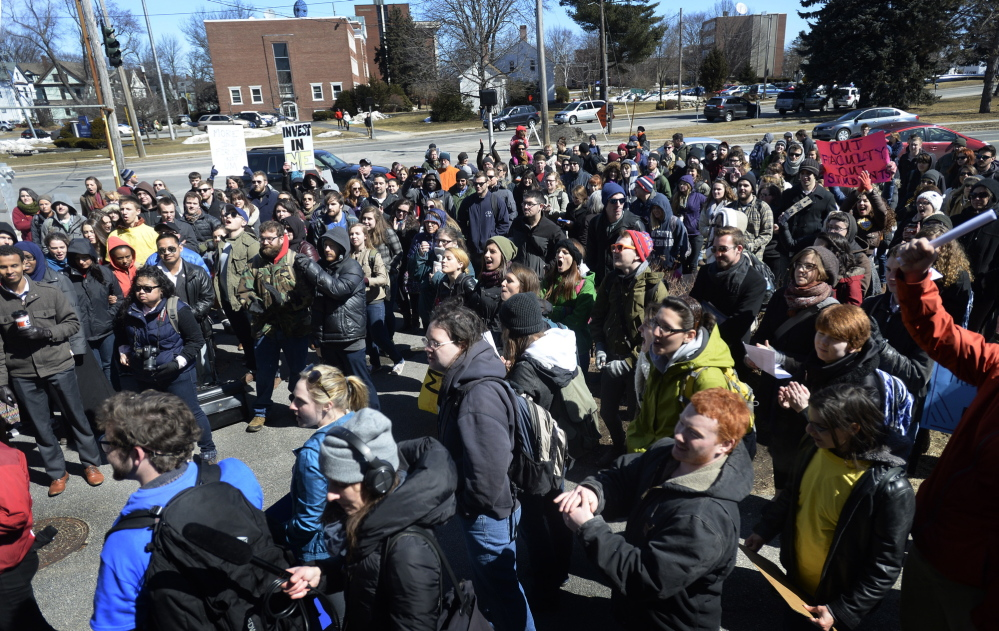 Students and faculty protest cuts at the University of Southern Maine on Monday.