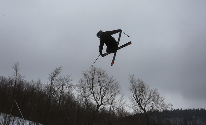 A skier clears the tree line while competing in the Dumont Cup on Friday.