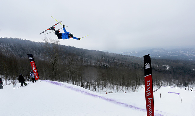 A skier extends all four limbs while clearing one of the big jumps at Sunday River. The Dumont Cup continues Saturday.