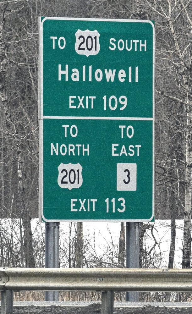 Signs such as these, which direct drivers to smaller cities and towns, would be taken down under a proposal.