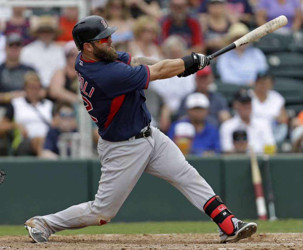 Boston's Mike Napoli hits a solo homer in the sixth inning of an exhibition game against the Minnesota Twins in Fort Myers, Fla., on Friday.