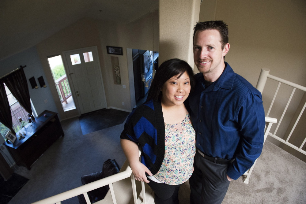 Jenny and Tim Haagen stand in their Tustin, Calif., condo, which they bought a little more than a year ago. In May 2010, the Haagens lost their jobs and moved in with Jenny's parents until they were re-employed and were able to purchase their new home.