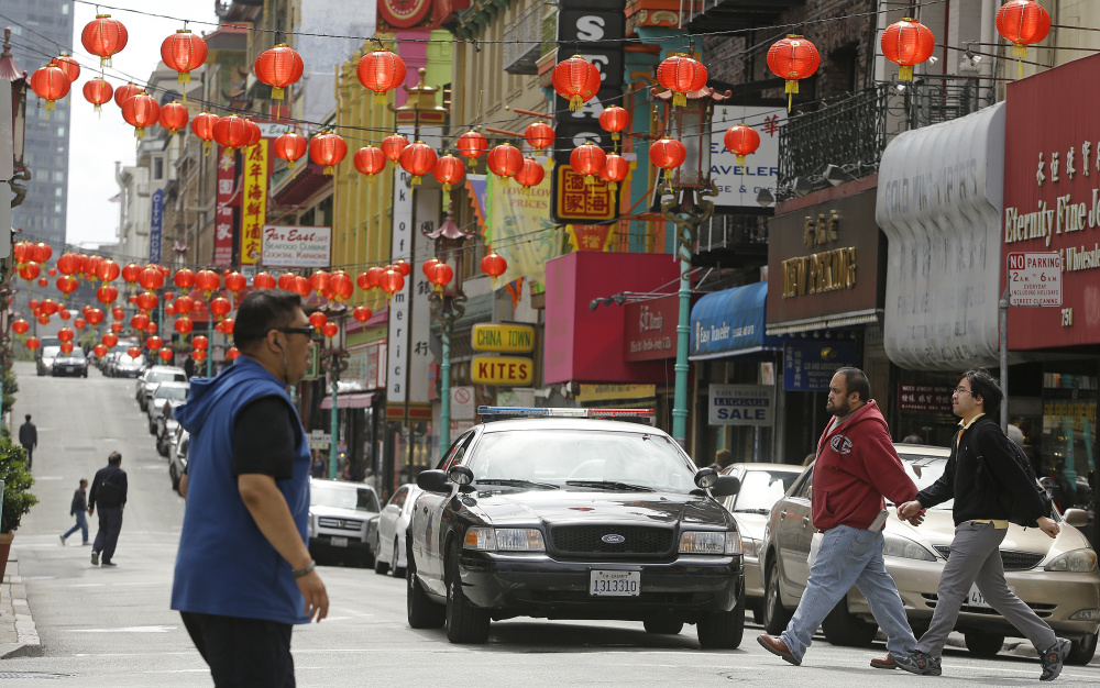 San Francisco police patrol the Chinatown district in San Francisco.
