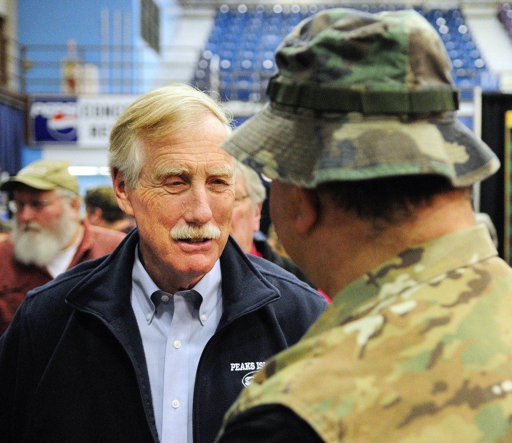 Sen. Angus King chats with a showgoer Saturday at the State of Maine Sportsman's Show in the Augusta Civic Center.