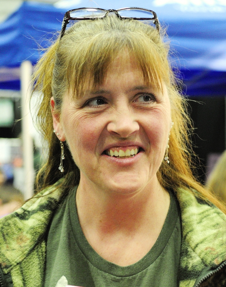 Lorri Nelson talks Saturday about the bear hunt referendum at the State of Maine Sportsman's Show in the Augusta Civic Center.
