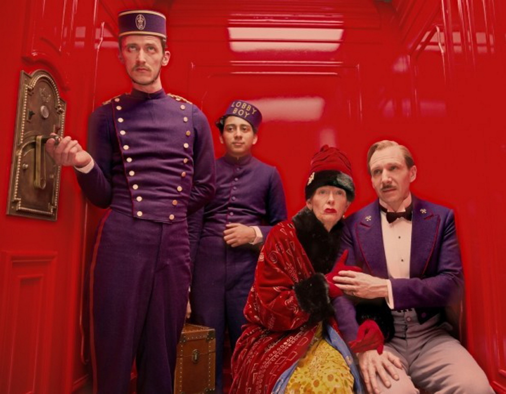 """From right, Ralph Fiennes, Tilda Swinton and Tony Revolori in a scene from """"The Grand Budapest Hotel."""""""
