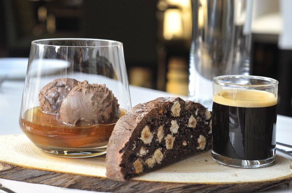 Desserts at C Square, the restaurant at the Westin Portland Harborview Hotel, include the Tipsy Affogato, in which chocolate ice cream is steeped in espresso and amaretto liqueur and accompanied by a housemade chocolate hazelnut biscotti.
