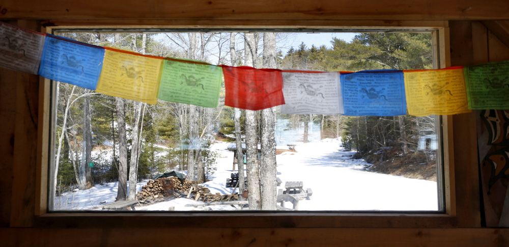 Prayer flags hang inside the Hi Hut, which was built during Hurricane Irene in 2011 at the Hidden Valley Nature Center, which is raising funds to expand its already impressive facilities.