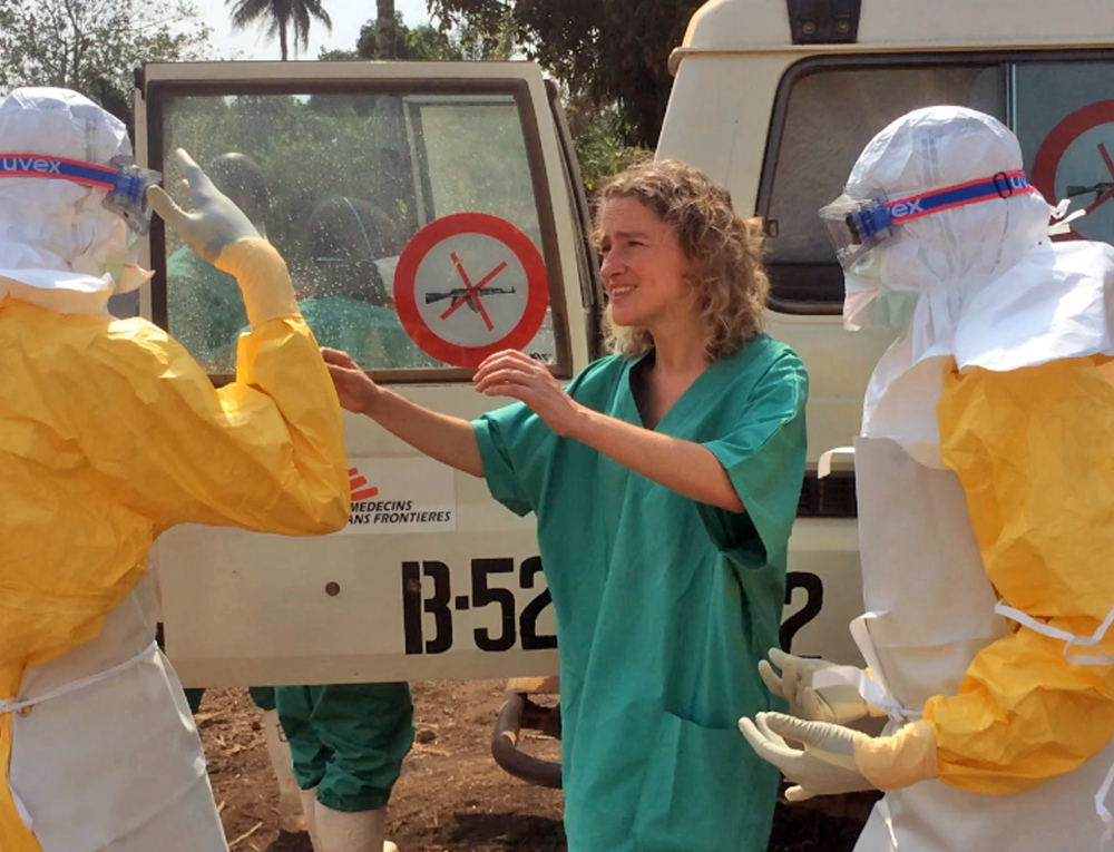 Health care workers prepare areas for their Ebola operations Friday in Gueckedou, Guinea. The outbreak has killed at least 70 people in the tiny West African country.