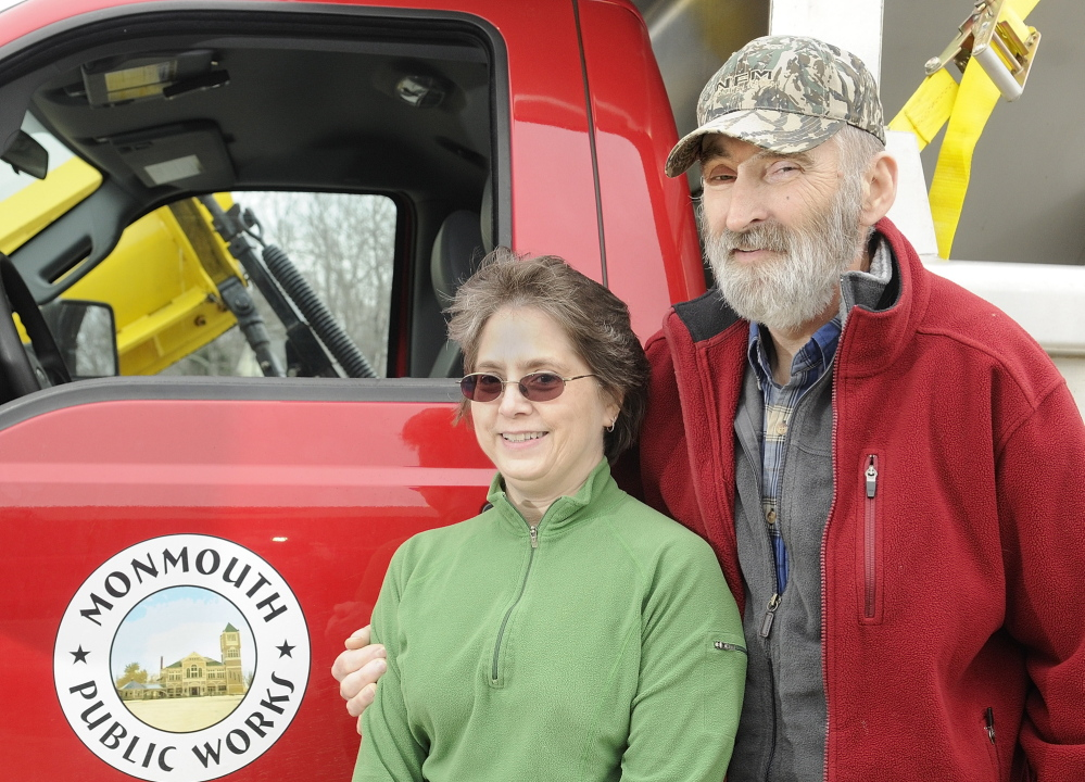 Cathy Crocker poses with her husband, Leonard Crocker, beside a Monmouth Public Works truck on Friday at the town garage. Cathy Crocker learned only upon arriving at a Lewiston hospital that her husband had suffered a heart attack, not complications from diabetes.
