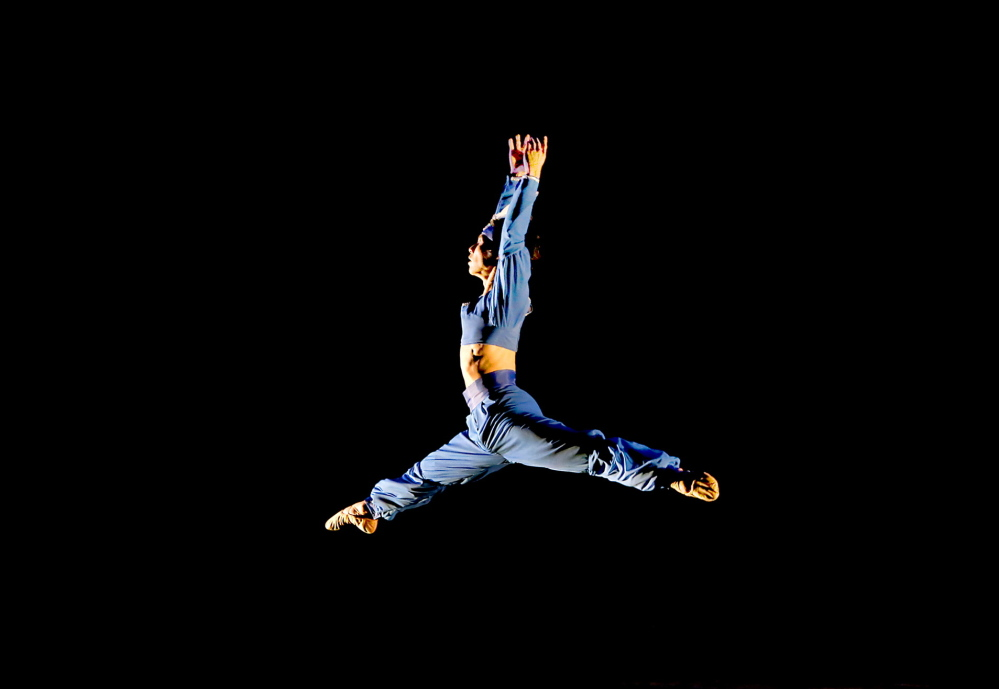 "Junichi Fukuda leaps across the stage during the Portland Ballet performance of ""Bolero to Bayadere"" at the Westbrook Performing Arts Center on Saturday."