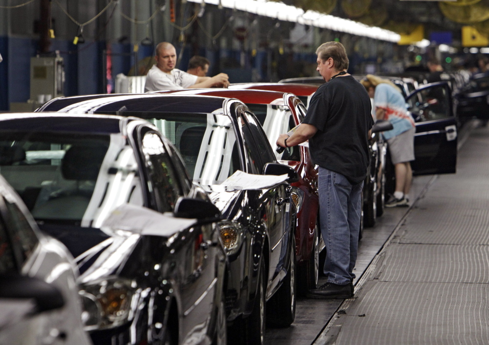 Workers at GM's plant in Lordstown, Ohio, put the final touches on Chevy Cobalts. U.S. safety regulators are demanding that GM turn over documents detailing when the company knew about a dangerous ignition problem that has been linked to 13 car-crash deaths.