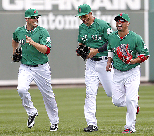 Exuberant and confident after last year's success, outfielders Daniel Nava, Grady Sizemore and Shane Victorino share a laugh while returning to the dugout during a St. Patrick's Day match-up against the St. Louis Cardinals.