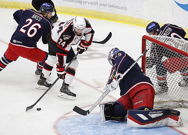 Brett Hextall of the Portland Pirates looks to beat Springfield's Mike McKenna in the first period of Portland's lopsided loss to the Falcons at the Colisee in Lewiston on Sunday. Hextall scored a second-period goal for the depleted Pirates.