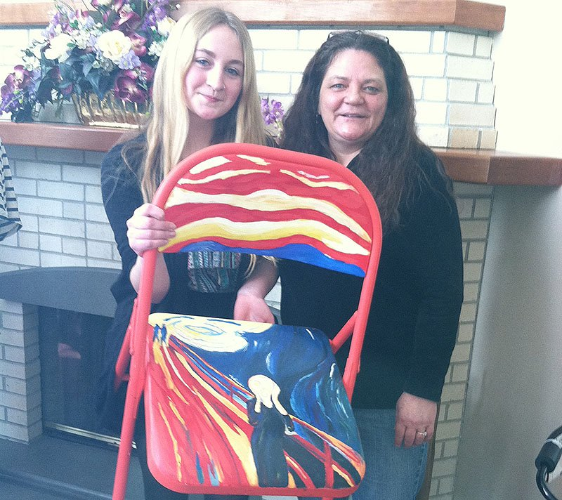 """Caitlyn Duffy holds up her chair artwork. Mom Sharlene Duffy, right, said she was """"blown away"""" by the thought process behind Caitlyn's decision to paint """"The Scream."""""""