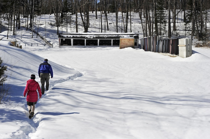 In this March 7 photo, Tammy Walter, club president, and Andy Tabor, past president, walk back to the shooting area at the Spurwink Rod & Gun Club. The Town Council unanimously approved a shooting range ordinance Monday night that members said will create a safer community.