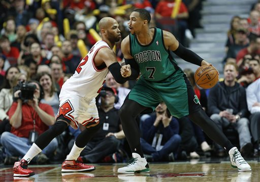 Chicago Bulls forward Taj Gibson, left, defends against Celtics center Jared Sullinger on Monday in Chicago. The Bulls won 94-80.