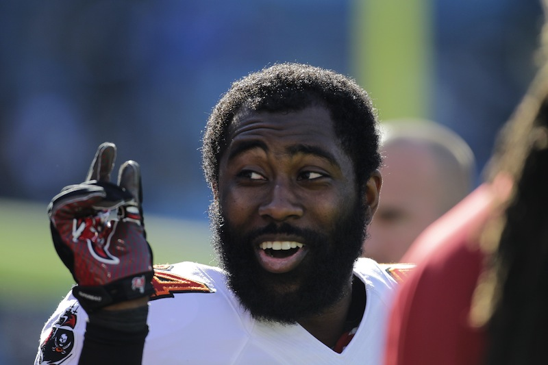 In this Dec. 1, 2013 file photo, former Tampa Bay Buccaneers' Darrelle Revis clowns around with teammates during warm ups before an NFL game. The Patriots have signed Revis to a two-year, $32 million contract.