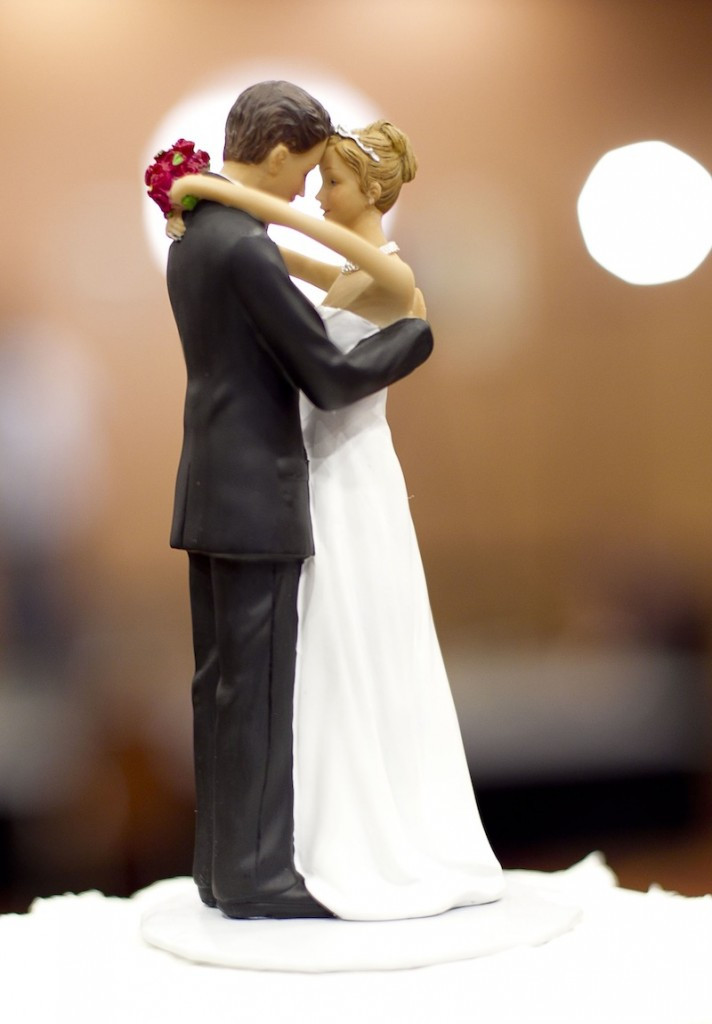 Figurines of a bride and a groom sit atop a wedding cake in Raleigh, N.C. A study of more than 3.5 million Americans finds that married people are less likely than singles, divorced or widowed folks to suffer any type of heart or blood vessel problem. The results were released Friday.