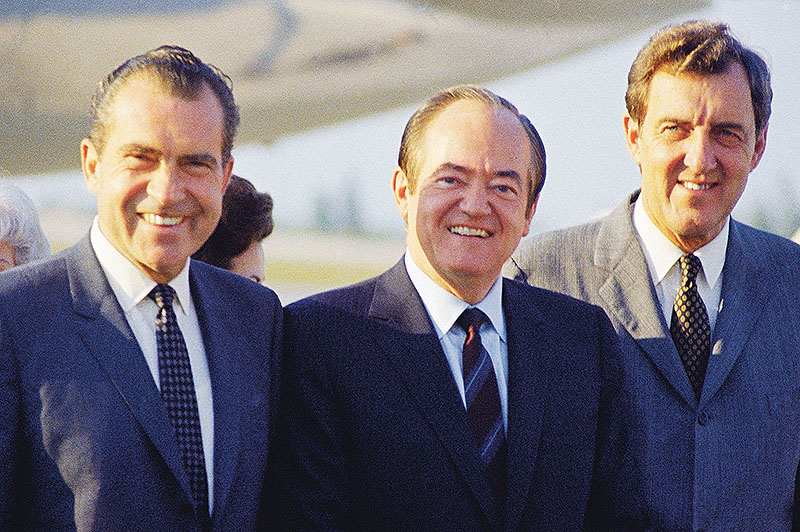 Richard Nixon, from left, Hubert Humphrey and Edmund Muskie pose for a photo in November 1968.