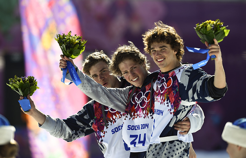 U.S. finalists second-placed Gus Kenworthy, winner Joss Christensen and third-placed Nicholas Goepper (L-R) celebrate on podium after the men's freestyle skiing slopestyle finals at the 2014 Sochi Winter Olympic Games in Rosa Khutor, February 13, 2014.
