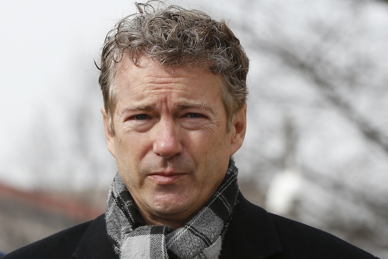 In this Feb. 12, 2014 file photo, Sen. Rand Paul, R-Ky., walks towards waiting reporters in front of federal court in Washington. Paul's biggest political decision is approaching: whether to run for president in 2016 or focus solely on re-election to his U.S. Senate seat. But a new bill could free him from that dilemma.