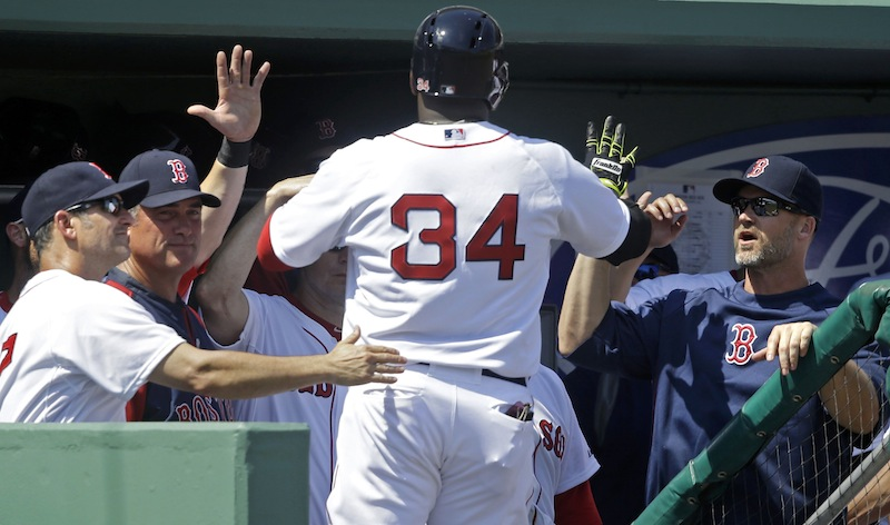 Boston Red Sox designated hitter David Ortiz (34) is greeted at the dugout after a solo homer in the third inning of an exhibition baseball game against the Tampa Bay Rays in Fort Myers, Fla., on Monday.
