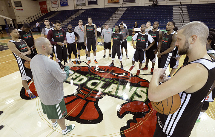 In this Nov. 8, 2013, photo, Red Claws Coach Mike Taylor starts team practice after the team's media day at the Portland Expo. RedClaws