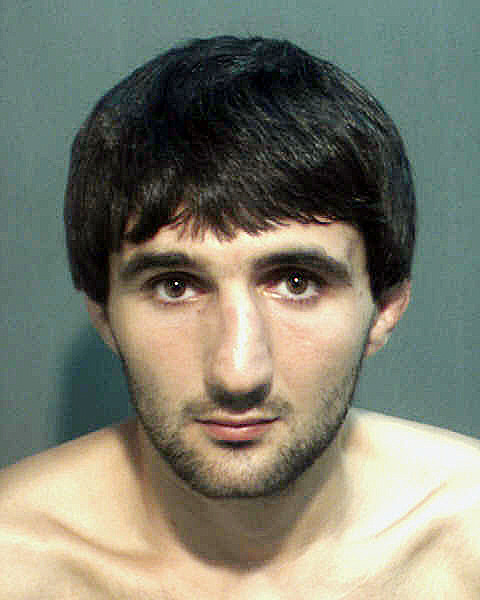 This is a May 4, 2013, police photo provided by the Orange County Corrections Department in Orlando, Fla., showing Ibragim Todashev after his arrest for aggravated battery in Orlando. He was fatally shot on May 22, 2013, when he initiated a violent confrontation, FBI officials said.