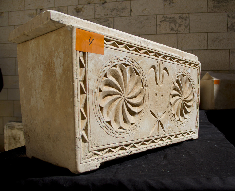 A 2,000-year-old burial box is shown on display in Jerusalem on Monday.