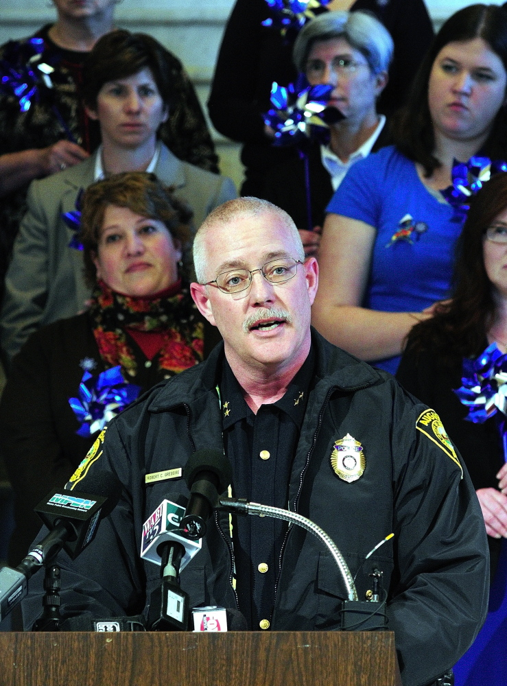 Augusta Police Chief Robert Gregoire speaks during a news conference held Tuesday in the Maine State House Hall of Flags to kick off Child Abuse Prevention Month.
