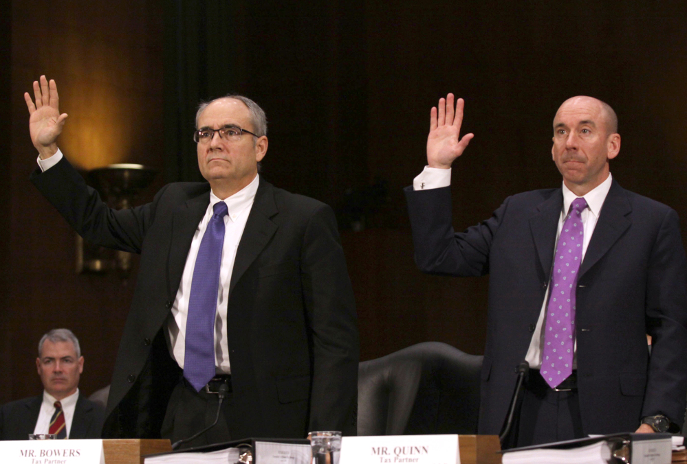 James Bowers, left, and Thomas Quinn, both tax partners at PricewaterhouseCoopers, are sworn in on Capitol Hill on Tuesday prior to testifying about Caterpillar's offshore tax strategy.