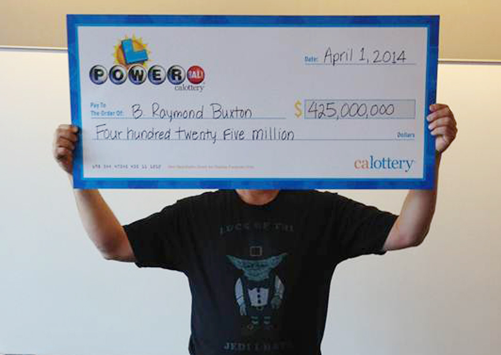 Powerball winner B. Raymond Buxton holds his $425 million check Tuesday in Sacramento, Calif. He is setting up a foundation focused on children's health, hunger and education.