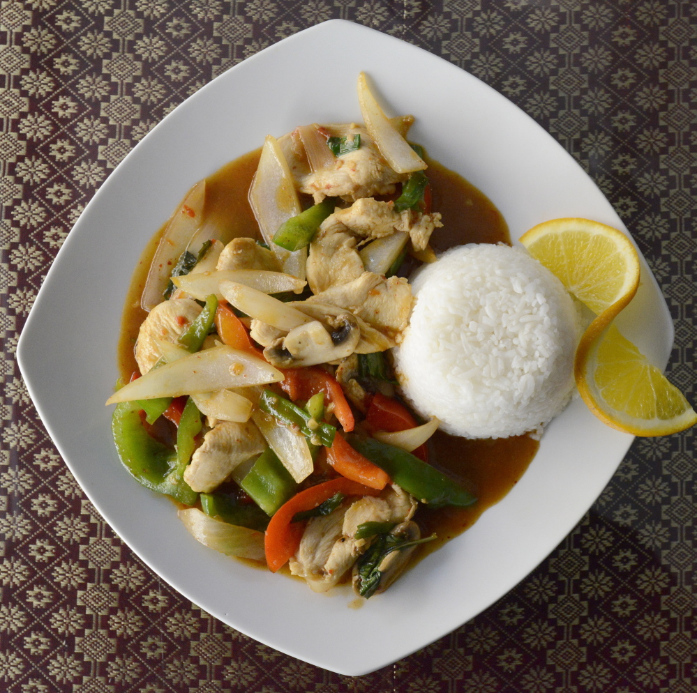 Thai 9's basil stir-fried chicken with mushroom, carrot, snow peas, broccoli, zucchini and onion in a light garlic sauce.