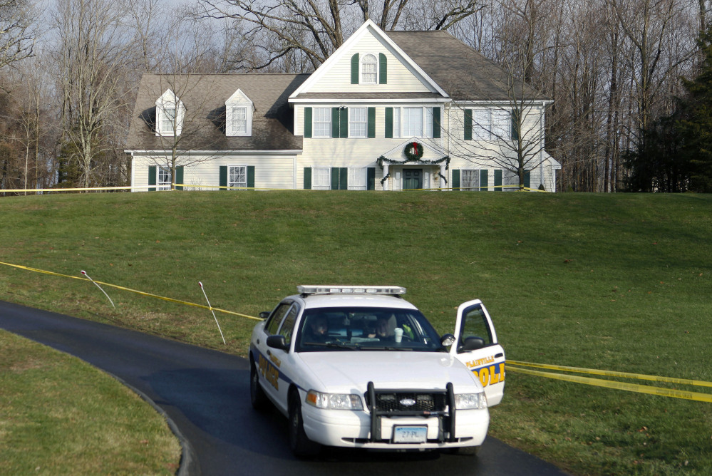 Crime scene tape surrounds the former home of Nancy Lanza, who was killed there by her son Adam Lanza before he forced his way into Sandy Hook Elementary School on Dec. 14, 2012, and killed 26 children and adults. Some Newtown residents say they want the home torn down and the property turned into a park or nature preserve.